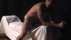 Hunky stud Thomas Bjorn shows off his body and strokes his dick until he cums